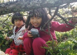 Nature Preschool girls playing outside