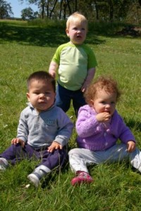 3 toddlers playing outside